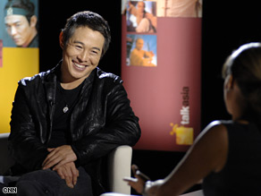 Chinese action star Jet Li shares a laugh with Anjali Rao on Talk Asia's live set in Bethanie Hall, Hong Kong.