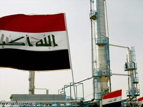 Iraqi flags flutter during the opening ceremony of a new oil refinery plant in the Shiite holy city of Najaf.