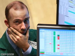 Floor traders at the Hong Kong Exchange react Tuesday to news of falling shares.