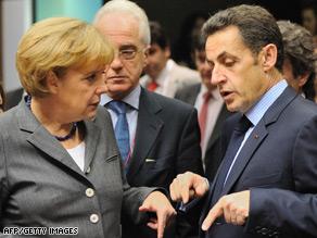German Chancellor Angela Merkel talks with French President Nicolas Sarkozy at Friday's meeting.