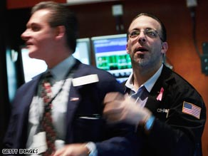 Professionals at the New York Stock Exchange react to the Fed announcement.