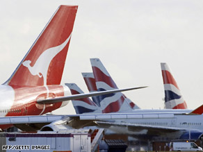 A Qantas aircraft is pictured beside British Airways aircraft at Heathrow airport, west of London, on December 4.