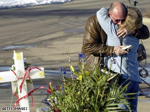 Relatives mourn after a gunman opened fire at a church meeting in Brookfield, Wisconsin, in 2005.