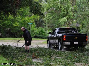 Downed tree branches are one of the first focuses of cleanup in Lafayette, Louisiana, after Hurricane Gustav.