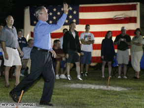 President Bush, shown playing horseshoes in 2004, also enjoys mountain biking.