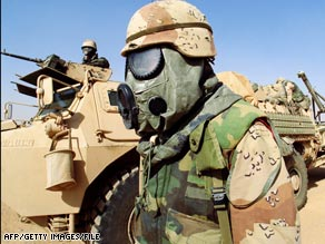 A U.S. soldier wears protection against chemical weapons during the Gulf War in a February 1991 photo.