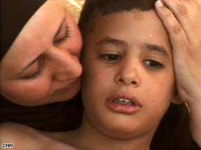 Wafaa al Nuaimi fled  Iraq with her three children, including Mustafa, 8, who has autism.