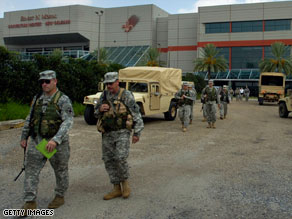 Louisiana National Guard members arrive at the New Orleans convention center during preparations for Gustav.