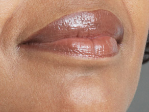 Dermatologists suggest using a lip balm with SPF 30 as a base layer under lip gloss or lipstick.