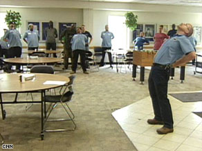 Howard Tegtmeier, right, leads co-workers in stretching before their shift starts at Lincoln Industries.
