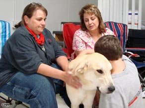 Karen Shirk's nonprofit 4 Paws for Ability has placed 319 service dogs with people with disabilities since 1998.