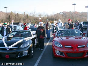 Saturn owners show off their Sky roadsters after a Christmas parade in Soddy-Daisy, Tennessee, on Sunday.