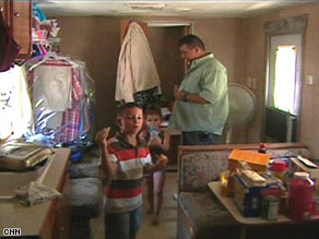Ricky Murray, his wife and their three children live in a few hundred square feet of a FEMA trailer.