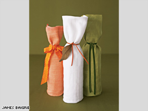 Wrapping wine bottles with dish towels is an elegant alternative to a Mylar bag.