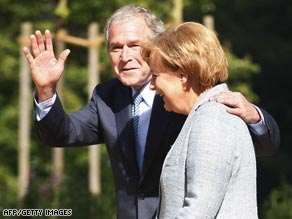 art.bush.merkel.afp.gi.jpg