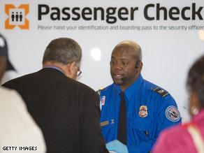 A TSA officer checks a passenger's ID at Baltimore-Washington International Airport.
