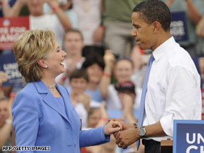 Once fierce rivals, Sens. Hillary Clinton and Barack Obama stand together in June in Unity, New Hampshire.