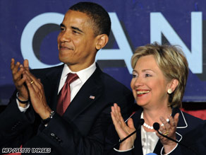 Sens. Barack Obama and Hillary Clinton appears together during a fundraiser in New York Thursday.