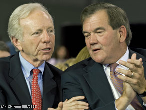 Sen. Joseph Lieberman, left, and Tom Ridge attend a McCain rally last week in York, Pennsylvania.