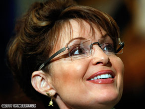 Palin's husband, Todd, holds a Bible as his wife gets sworn in as governor in December 2006.