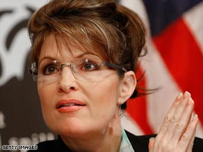 Alaska Gov. Sarah Palin has put an aide on leave during a probe into the firing of the public safety commissioner.