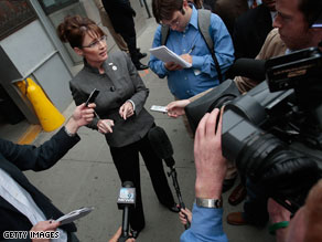 Gov. Sarah Palin speaks with a handful of reporters in Manhattan on Thursday.