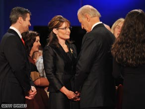 After Thursday's debate, Alaska Gov. Sarah Palin, Sen. Joe Biden and their families mingled on stage.