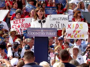 "McCain-Palin supporters offer ""no lip service"" signs at Tuesday's event in Jacksonville."