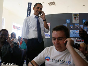 Barack Obama calls a prospective voter from a headquarters in Kansas City, Missouri, on Saturday.