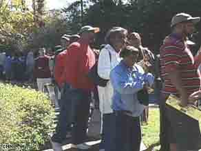 Early voters in North Carolina wait in lines for hours.