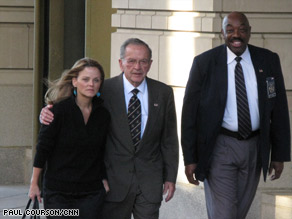 Sen. Ted Stevens leaves the federal courthouse Tuesday evening with his daughter Beth Stevens.