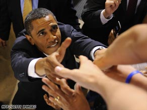 Barack Obama greets supporters at the end of a rally at the Richmond Coliseum in Richmond, Virgina.
