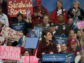 Palin supporters braved chilly conditions and heavy rains to greet the Republican vice-presidential candidate.
