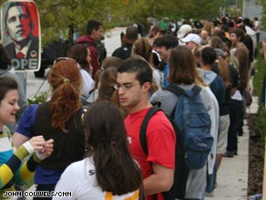 Students wait in a long line to vote Tuesday on the campus of the University of Central Florida.