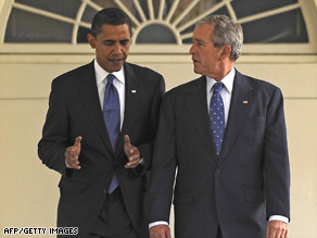 President-elect Barack Obama walks along the White House Colonnade with President Bush on Monday.