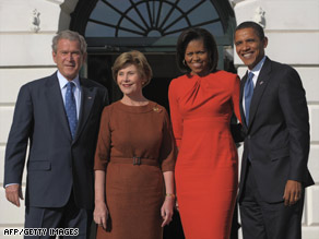 First lady Laura Bush visits with Michelle Obama on Monday during the Obamas' visit to the White House.