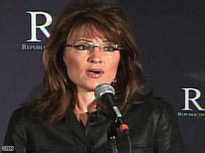 Alaska Gov. Sarah Palin talks to reporters at the GOP governors' group meeting Thursday in Miami, Florida.