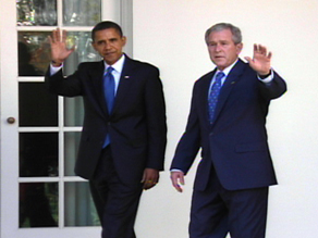 Obama and President Bush wave to reporters as they head into the Oval Office Monday.