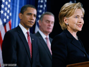 Sen. Hillary Clinton addresses the media in Chicago on Monday while President-elect Barack Obama looks on.