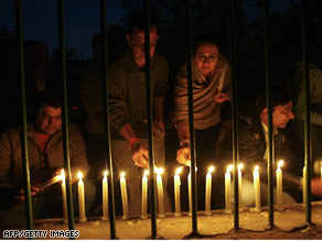 People in New Delhi, India, take part in a candlelight vigil for the victims of the Mumbai attacks on Sunday.