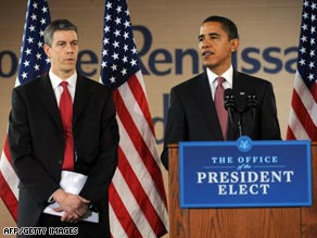 Arne Duncan listens Tuesday as President-elect Obama announces him as his choice for education secretary.