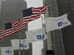 Flags fly outside of the General Motors Corporation in Detroit, Michigan.