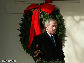 President Bush walks down the White House Collonade on Tuesday as he departs for Camp David.