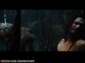 "D'Leh (Steven Strait) comes face to face with a saber-tooth tiger in Roland Emmerich's ""10,000 BC."""