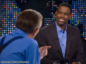 Comedian Chris Rock told Larry King he's proud of Barack Obama's character.
