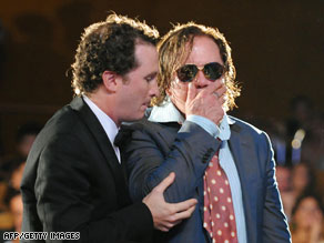 "Director Darren Aronofsky (L) and actor Mickey Rourke upon winning the Golden Lion award for ""The Wrestler"" at the Venice Film Festival."