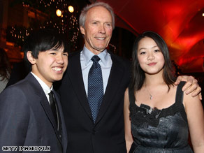 "Clint Eastwood attends the ""Gran Torino"" premiere this month with actors Bee Vang, left, and Ahney Her."
