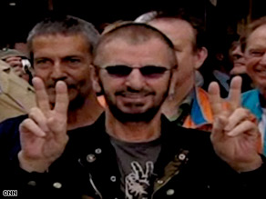 "Ringo Starr wishes peace and love to everyone following Larry King singing ""Happy Birthday"" to him."