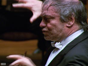 Valery Gergiev uses his eyes to convey the feeling of the score while performing with the London Symphony Orchestra.