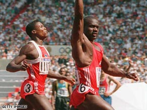 Johnson, right, finished several meters clear of archrival Carl Lewis.